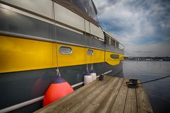 Yacht is at anchor and wooden jetty. Transport Stock Photos