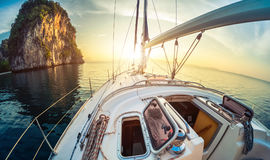 Yacht. Anchored in a calm bay at sunrise royalty free stock photo