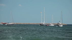The yacht is anchored next to the beach area. Spanish beaches in Costa d`en Blanes. Mallorca stock footage
