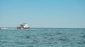 The yacht is anchored next to the beach area. Spanish beaches in Mallorca. Hydrocycle