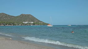 The yacht is anchored next to the beach area. Spanish beaches in Mallorca stock video footage