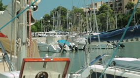 The yacht is anchored next to the beach area. Spanish Parking for yachts in a provincial town Porto Cristo. Mallorca stock video footage