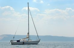 Yacht Anchoring beside coast Stock Photography