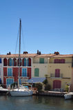 Yacht and apartments at Port Grimaud. Yacht and colourful apartments at Port Grimaud, on the French Riviera Stock Images