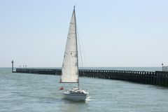 Yacht approaching Littlehampton. England Stock Photo
