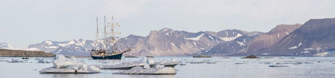 Yacht in the Arctic fjord - panorama Royalty Free Stock Image
