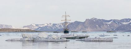 Yacht in the Arctic fjord - panorama Stock Image
