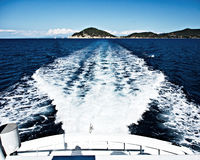 With a yacht around Elba island. Image of boat trails when traveling around Elba island in Italy. A bright summer day with deep blue tones royalty free stock photo