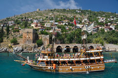 A yacht on the background of the fortress in Alanya Royalty Free Stock Images