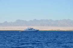 Yacht on a background of mountains in Egypt Stock Images