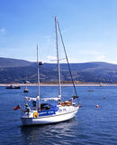 Yacht in barmouth harbour. Stock Image