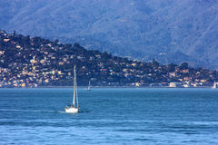 Yacht in the bay. Yacht in front of the bay Royalty Free Stock Image