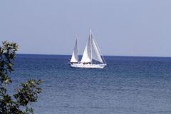 Yacht in the bay. Large yacht coming into the bay on lake Michigan royalty free stock photo