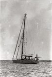 Yacht in the bay at anchor. Old retro photo Royalty Free Stock Photography