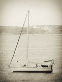 Yacht in the bay at anchor. Old retro photo Stock Photos