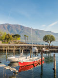 Yacht in bay in lake, Locarno, Switzerland. LOCARNO - APRIL 7 : Yacht boats float on bay in Lake Maggiore in Locarno, Switzerland, on April 7, 2017 Royalty Free Stock Photography