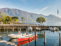 Yacht in bay in lake, Locarno, Switzerland Stock Photo