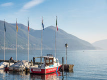 Yacht in bay in lake, Locarno, Switzerland. LOCARNO - APRIL 7 : Yacht boats float on bay in Lake Maggiore in Locarno, Switzerland, on April 7, 2017 Royalty Free Stock Image