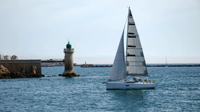 Yacht in the bay. Lighthouse sea port Stock Photo