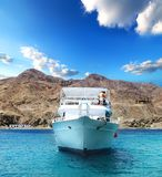 Yacht in a bay. Motor yacht in a bay of the red sea. Egypt Royalty Free Stock Photo