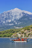 Yacht in a bay on mountains background Stock Images