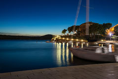 Yacht in a bay at night Royalty Free Stock Photography
