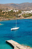 Yacht at the beach of luxury hotel Royalty Free Stock Image