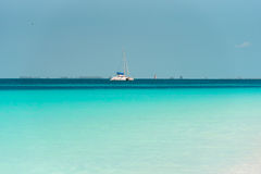 Yacht at the beach Playa Paradise of the island of Cayo Largo, Cuba. Copy space for text. Yacht at the beach Playa Paradise of the island of Cayo Largo, Cuba Royalty Free Stock Photos