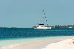 Yacht at the beach Playa Paradise of the island of Cayo Largo, Cuba. Copy space for text. Yacht at the beach Playa Paradise of the island of Cayo Largo, Cuba Stock Photography