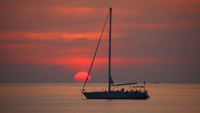Yacht on a beautiful sunset background stock video footage
