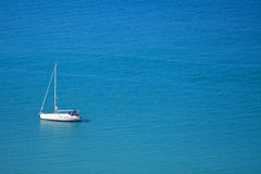 Yacht on a blue sea Royalty Free Stock Image