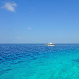 Yacht on the blue sea. With blue sky Royalty Free Stock Image