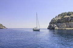 Yacht in the blue sea. Rhodes Island. Greece Royalty Free Stock Images