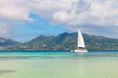 Yacht and blue water near seychelles Stock Photos