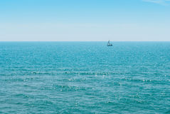 Yacht and blue water ocean Royalty Free Stock Photo
