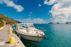 Yacht boat anchored at sea pier on tropical beach in gustavia, st.barts. Yachting and sailing. Luxury travel on boat. Summer vacation on island. Water royalty free stock image