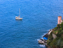 Yacht. The boat floating in the Atlantic Ocean to the coast. Island Madeira stock photography