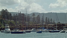 Yacht Boat Harbour Establishing Shot - Wollongong Illawarra NSW. Yacht Boat Harbour Establishing Shot of Wollongong, a is a seaside city located in the Illawarra stock video footage