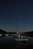 Yacht boat on lake. Night landscape with stars Stock Photography