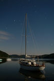 Yacht boat on lake. Night landscape with stars trails Royalty Free Stock Photo