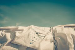 Closeup of sails white fabric on blue sky background. Yacht and boat objects concept. Closeup of sails white fabric on blue clear sky background royalty free stock photo