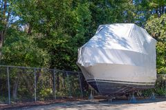 Yacht on boat stands with shrink wrap Stock Photos
