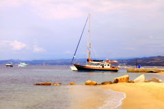Yacht boats, pier and sand beach,  Mediterranean Sea, Greece Stock Images