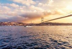 Yacht and Bosphorus Bridge at sunset stock photos
