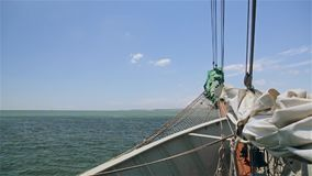 Yacht bow with a sail on background of ocean stock video footage