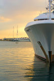 Yacht bow. View of a luxury yacht bow and other yachts at the background royalty free stock photography
