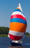 Yacht with brightly colored sails Royalty Free Stock Images