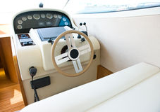 Yacht cabin. Steering wheel on a luxury yacht cabin Royalty Free Stock Images