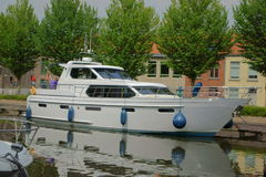 Yacht in a canal of Brugge Royalty Free Stock Photo