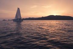 Yacht - Catamaran in the ocean. Sailing at sunset Stock Image